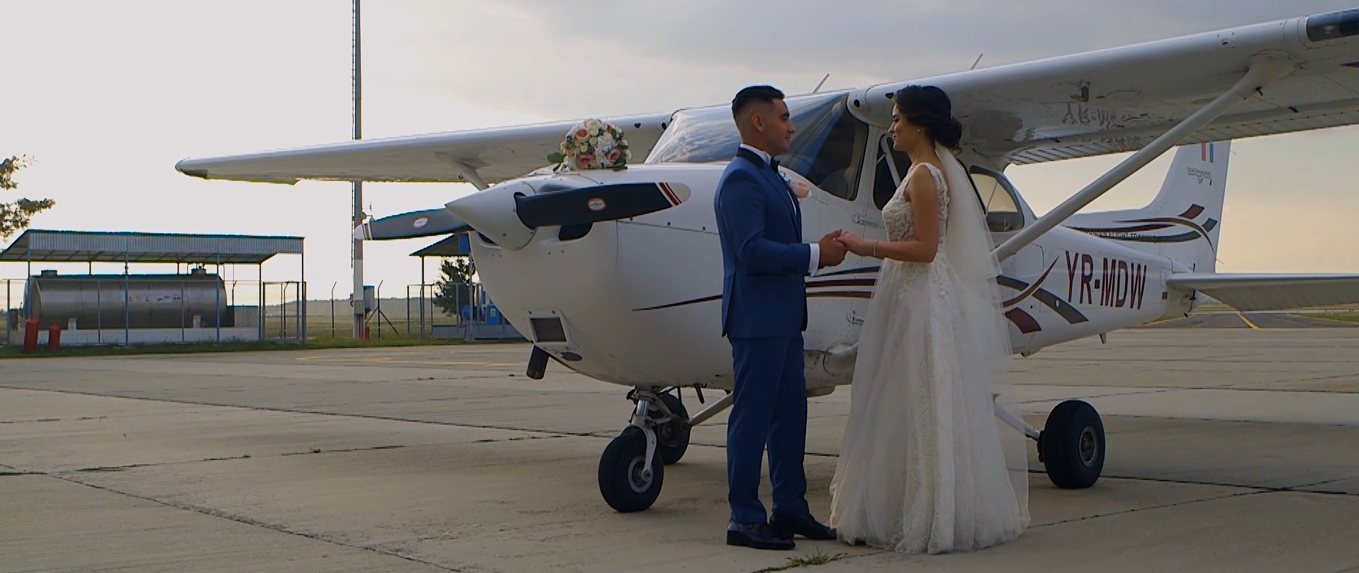 bride and groom with a plane